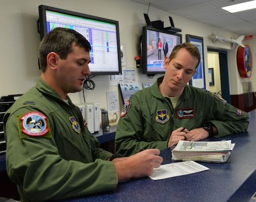 Capt. Chris Umphres (right), 435th Fighter Training Squadron flight commander and instructor pilot, conducts a pre-flight briefing with First Lt. Kaleb Jenkins, 435th FTS student pilot, before a training mission Jan. 5 at Joint Base San Antonio-Randolph, Texas. (U.S. Air Force photo by Tech. Sgt. Beth Anschutz)