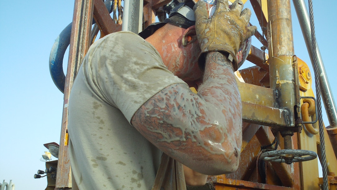 Tech. Sgt. John Sinner works on a water well during a deployment to Afghanistan in 2010. Before becoming an academy military trainer at the U.S. Air Force Academy in 2013, Sinner was an Air Force civil engineer paving and heavy equipment operator. (U.S. Air Force photo)