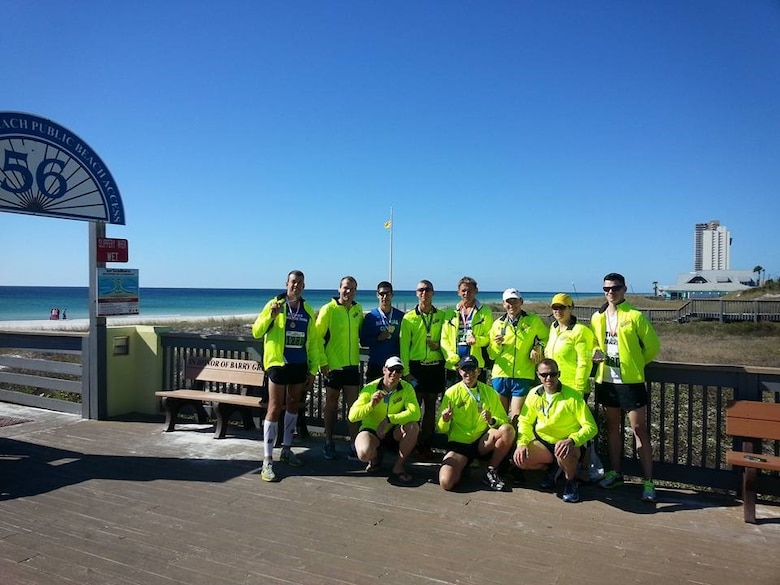 Photo of member of the National Guard Marathon Team that participated in the Panama City Beach Marathon. 132d Wing members Staff Sgt. Curt Brass and Senior Airman Tag Noel helped earned some medals for the award winning team.
