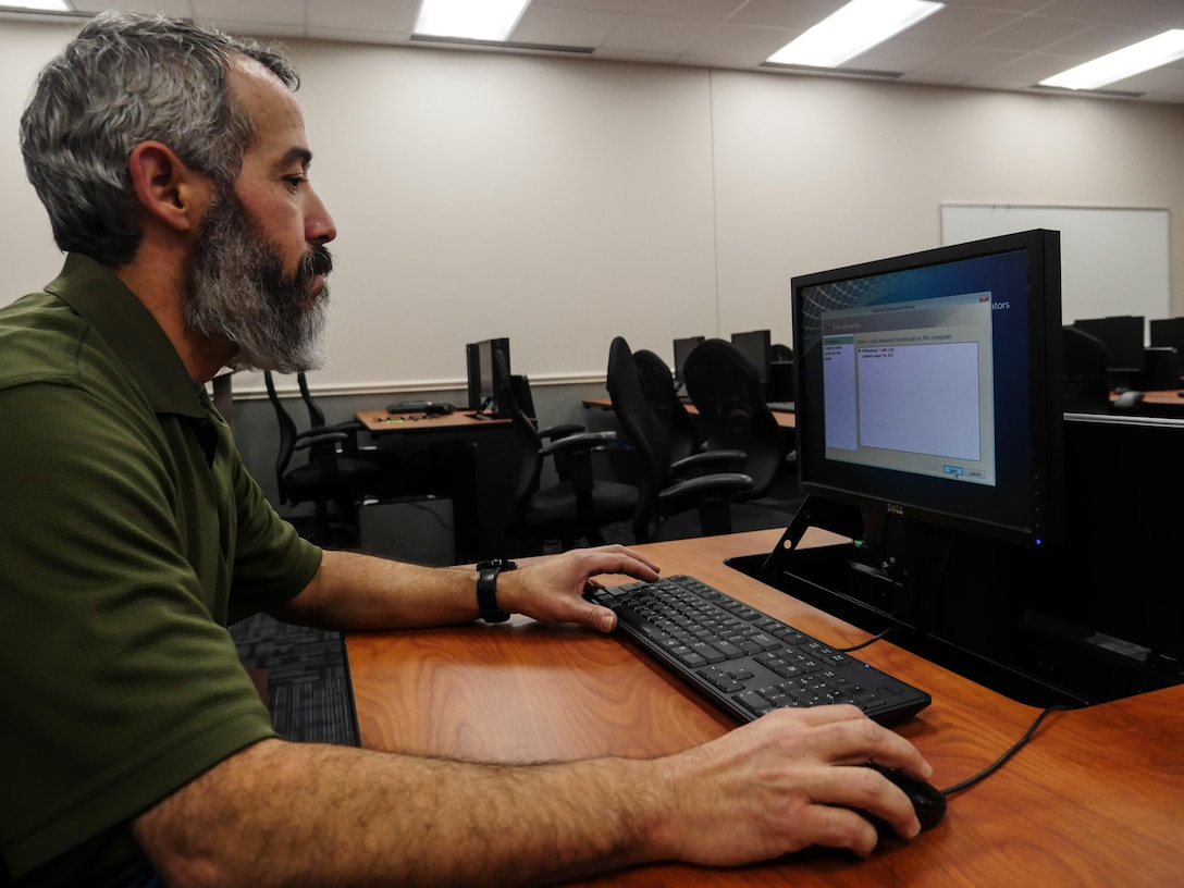 Rob Phelps, Defense Information School information technology operations manager, images a computer at DINFOS on Fort Meade, Md., Jan. 7, 2016. The IT team led the effort to plan and execute the successful running of 236.2 miles of cable, installation of 1,978 data drops and 450 phone drops, and the transfer of 2,400 computer systems from south campus to the main campus to prepare for training in the new wing.