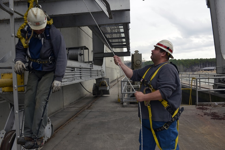 Josh Kinser, an electrician at Kentucky Lock and Dam simulates rescueing Ramiro Santoyo, a hydropower mechanic at the Cheatham power plant during a fall and rescue protection training class at the Cheatham Dam and power plant in Ashland City, Tenn. 140 personnel from the U.S. Army Corps of Engineers, Nashville District, Operations Division recently completed required fall and rescue protection training.