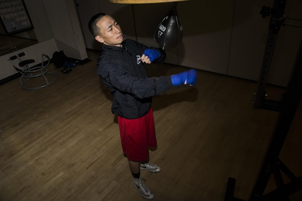 Senior Airman Dustin Southichack, 902nd Security Forces Squadron entry controller, performs speed bag drills Jan. 5, 2015 at the Joint Base San Antonio-Randolph Rambler Fitness Center. Southichack has competed on the Air Force Boxing Team since 2012, and his goals include retiring from the Air Force Reserves and becoming a boxing world champion. (U.S. Air Force photo by Senior Airman Alexandria Slade)