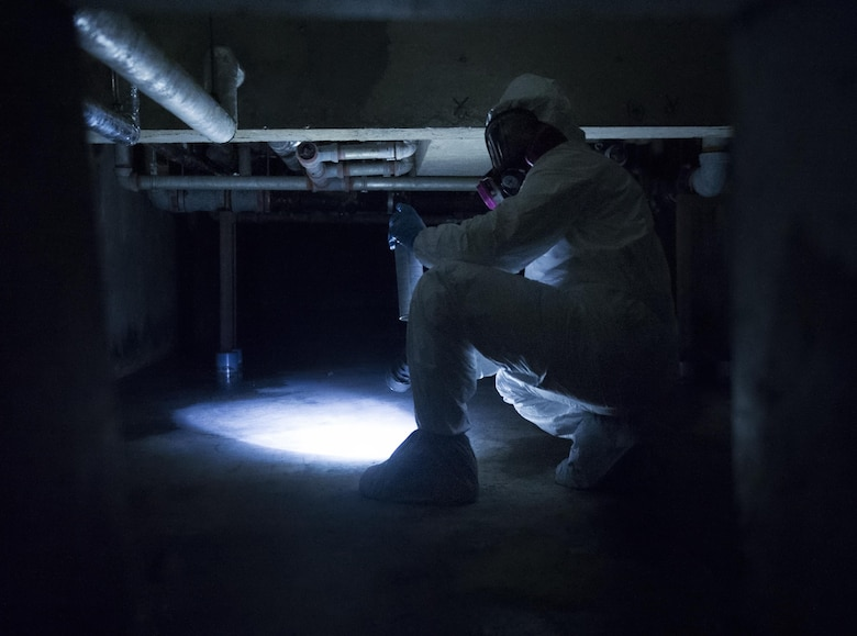 Staff Sgt. Brandon Cenarrusa, a 374th Civil Engineer Squadron pest management craftsman, inspects the crawlspace at Yokota Air Base, Japan, Jan. 6, 2016. To ensure that facilities on Yokota AB remain pest free, entomology Airmen identify and repair any infrastructure imperfections that may lead to pest. (U.S. Air Force photo/Airman 1st Class Delano Scott)