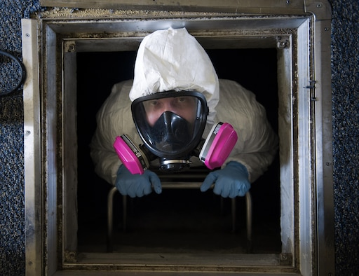 Staff Sgt. Brandon Cenarrusa, a 374th Civil Engineer Squadron pest management craftsman, climbs out of a crawlspace at Yokota Air Base, Japan, Jan. 6, 2016. From performing disease vector surveillance to providing base-wide pest control services for insects and wildlife, entomology Airmen utilize both preventative and immediate response maintenance practices to ensure that facilities remain pest free. (U.S. Air Force photo/Airman 1st Class Delano Scott)