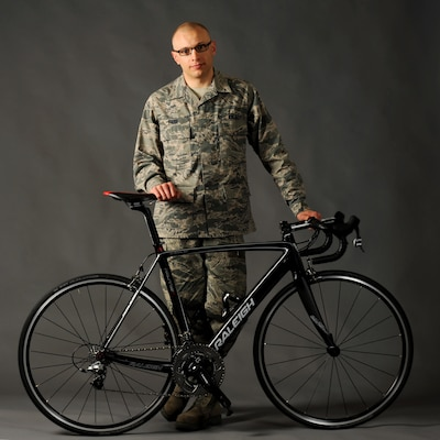 Air Force Tech. Sgt. Dwayne Farr, assigned to the Oregon Air National Guard's 142nd Fighter Wing Aircraft Maintenance Squadron , poses with one of his bicycles on Portland Air National Guard Base, Ore., April 7, 2013. Farr has been training and racing as an endurance cyclist for the past four years and was part of the Military World Games in Mungyeoung, Korea, last year. Air National Guard photo by Air Force Tech. Sgt. John Hughel