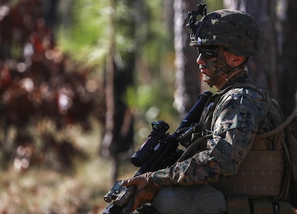 A U.S. Marine with Battalion Landing Team, 1st Battalion, 6th Marine Regiment (BLT 1/6), 22nd Marine Expeditionary Unit,  patrols through the woods of Camp Lejeune, N.C., Dec. 16, 2015. The exercise allowed the Marines to practice setting up patrol bases and enhances basic infantry principles. (Official Marine Corps photo by Cpl. Ryan G. Coleman/released)