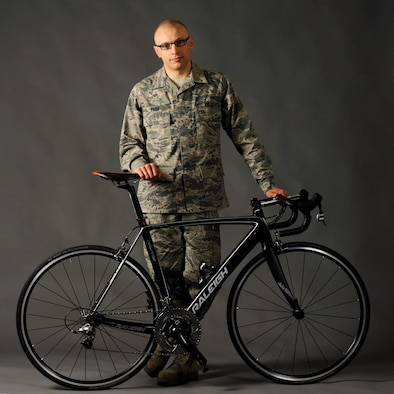 Tech. Sgt. Dwayne Farr, assigned to the Oregon Air National Guard's 142nd Aircraft Maintenance Squadron, poses with one of his bicycles on Portland Air National Guard Base, Ore., April 7, 2013. Farr has been training and racing as an endurance cyclist during the past four years and was part of the Military World Games in Mungyeoung, South Korea, Oct. 6, 2015. (U.S. Air National Guard photo/Tech. Sgt. John Hughel)
