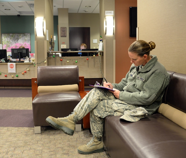 Master Sgt. Brandi Burns, 2nd Force Support Squadron first sergeant, fills out paperwork for an appointment at the 2nd Medical Group at Barksdale Air Force Base, La., Dec. 28, 2015. The 2nd MDG has an appointment reminder system in place which calls patients two days prior to an appointment with a message identifying the appointment date and time. However, the appointment reminder system uses phone numbers listed in the Defense Enrollment Eligibility Reporting System, so it's critical to maintain updated contact information in DEERS. (U.S. Air Force photo/Airman 1st Class Curt Beach)