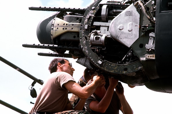 Staff Sgt. Brian D. Land checks a .50-caliber tail turret gun on a B-52G Stratofortress aircraft during Operation Desert Shield. (Courtesy photo)