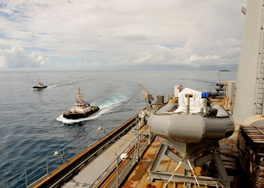 DIEGO GARCIA (Jan. 6, 2016) Tugboats come alongside the submarine tender USS Emory S. Land (AS 39) as she approaches Diego Garcia. Emory S. Land is a forward deployed expeditionary submarine tender on an extended deployment conducting coordinated tended moorings and afloat maintenance in the U.S. 5th and 7th Fleet areas of operations. (U.S. Navy photo by Mass Communication Specialist 3rd Class Austin L. Ingram/Released)