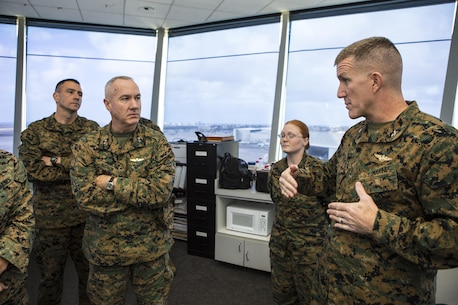 U.S. Marine Corps MajGen. Charles L. Hudson, commanding general of Marine Corps Installations Command, receives a brief from Col. Jason G. Woodworth, commanding officer of Marine Corps Air Station Miramar, about flightline operations aboard MCAS Miramar, San Diego, Calif., Dec. 11, 2015. MajGen. Hudson inspects the base for collateral in hope to improve quality and mission for Marines stationed aboard MCAS Miramar. (U.S. Marine Corps photo by Lance Cpl. Travis Jordan/Released)