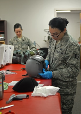 Staff Sgt. Andrea Mulgado, 9th Operations Support Squadron Aircrew Flight Equipment technician, conducts a routine inspection on a flight helmet Jan. 7, 2016, at Beale Air Force Base, California. Beale's Aircrew Flight Equipment technicians ensure T-38 Talon pilots are equipped with well-maintained and serviceable flight-gear. The T-38 is primarily used by the Air Education and Training Command as a training aircraft, but at Beale it is used as a familiarization aircraft when pilots are not flying the U-2 Dragon Lady. (U.S. Air Force photo by Airman 1st Class Ramon A. Adelan)