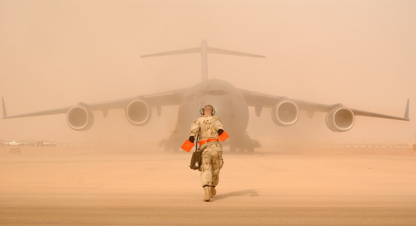 JOINT BASE CHARLESTON, SC -- In support of OIF, 15 C-17As from the 437th and 62nd AWs took off from Aviano AB, Italy, and airdropped 1,000 Sky Soldiers. At a staging base in Europe, C-17s from McChord AFB and Charleston AFB line the pad in preparation for airdrop and airland missions to Iraq. On the first night, they dropped 20 members of the 86th Expeditionary Contingency Response Group along with more than a thousand paratroopers (Sky Soldiers) from the 173d Airborne Brigade. This marked the first C-17 combat insertion of paratroopers. On subsequent nights, they delivered more than a million pounds of personnel and cargo. (Courtesy Photo)