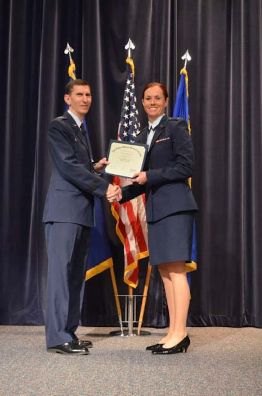 1st Lt. Hilary Styer, the 111th Attack Wing's full-time staff judge advocate at Horsham Air Guard Station, Pennsylvania, accepts a graduation certificate from Lt. Gen. Christopher Burne, The Judge Advocate General, Headquarters U.S. Air Force, Washington, D.C., during the Judge Advocate Staff Officer Course graduation April 2015, at Randolph Air Force Base, Texas. Styer worked in civilian-sector criminal defense and family law before joining the Pa. Air National Guard. (U.S. Air National Guard photo by submitted/Released)
