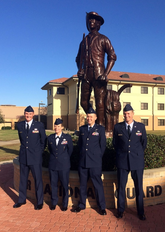 120th Airlift Wing 2nd Lieutenants Matthew Hall, Alissa Engel, Bradford Lewis, and Joshua Briggs pose at the statue to the Air National Guard minuteman located on the campus of the Officer Training School at Maxwell Air Force Base, Ala. Dec. 18, 2015. (U.S. Air National Guard photo by Capt. Kenneth Fechter/Released)