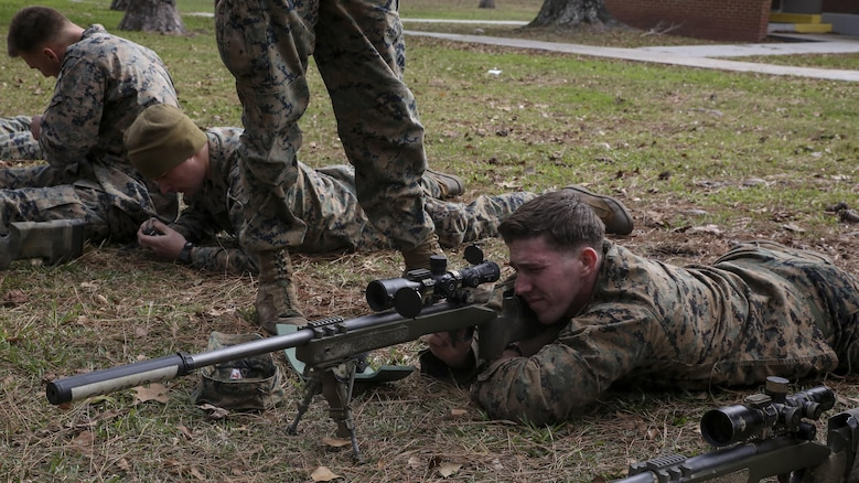 A Marine student undergoing the 2nd Marine Division Combat Skills Center Pre-Scout Sniper Course looks through an M40A5 sniper rifle at Marine Corps Base Camp Lejeune, North Carolina, Jan. 6, 2016. The 2nd Marine Division Combat Skills Center offers several infantry-based courses to enhance the combat readiness of its Marines.