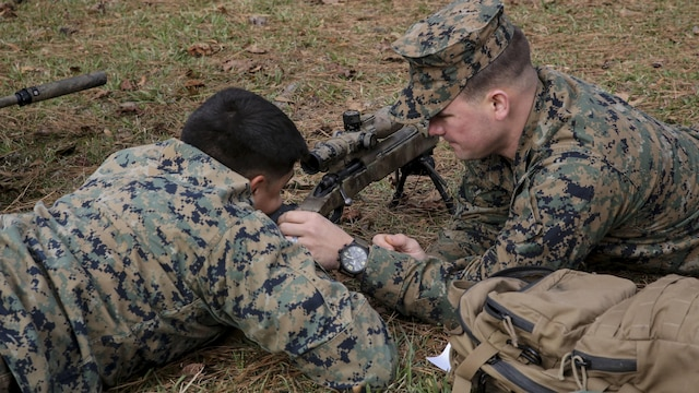 Marine students undergoing the 2nd Marine Division Combat Skills Center Pre-Scout Sniper Course adjust an M40A5 sniper rifle at Marine Corps Base Camp Lejeune, North Carolina, Jan. 6, 2016. The three-week course is designed to prepare qualified Marines for the Scout Sniper Basic Course, and instructs them in skills such as stalking, camouflage, land navigation and marksmanship.