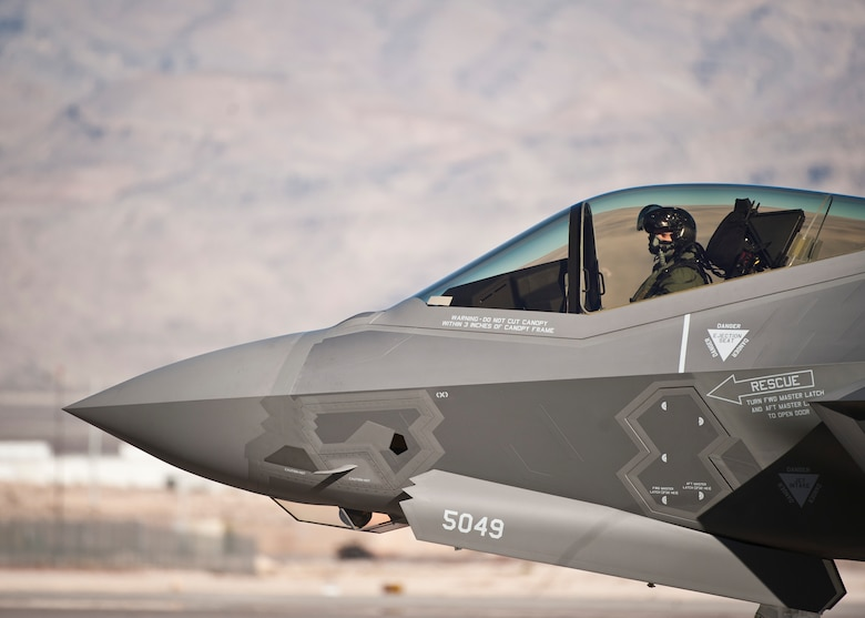 Capt. Brent Golden taxies an F-35A Lightning II at Nellis Air Force Base, Nev., Jan. 15, 2015. The F-35 that Golden, a 16th Weapons Squadron instructor, flew is the U.S. Air Force Weapons School's first assigned F-35. (U.S. Air Force photo/Staff Sgt. Siuta B. Ika)