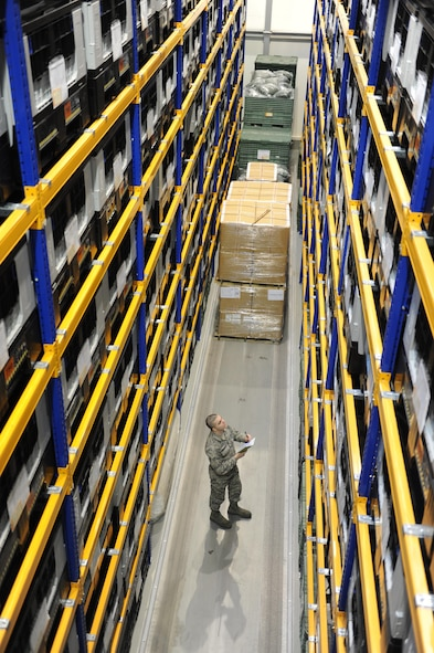 Airman 1st Class Alexander Hershberger takes inventory of storage bins Jan. 28, 2015, on Ramstein Air Base, Germany. During an average week, the 86th Logistics Readiness Squadron's individual protective equipment team processes about 130 to 150 service member's individual protective gear, ranging from bases all over U.S. Air Forces in Europe and Air Forces Africa. Hershberger is an IPE assigned to the 86th LRS. (U.S. Air Force photo/Airman 1st Class Michael Stuart)