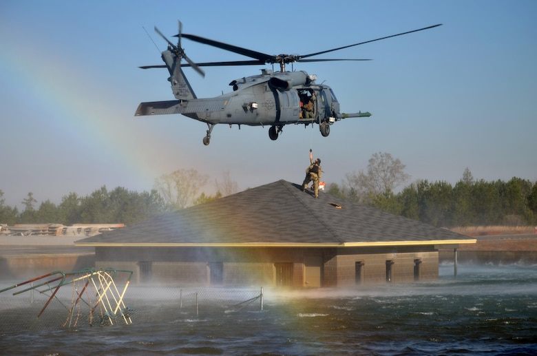 Pararescue jumpers and combat rescue officers conduct a search and rescue response during Hurricane Katrina-like flood training March 8, 2015, in Perry, Ga. The four-day exercise used HH-60 Pave Hawks and MV-22 Ospreys for simulated scenarios that included earthquake collapsed buildings, vehicle-borne improvised explosive devices detonating, and mass casualty responses. The pararescue jumpers and rescue officers are from the 920th Rescue Wing at Patrick Air Force Base, Fla. (U.S. Air Force photo/Staff Sgt. Kelly Goonan)