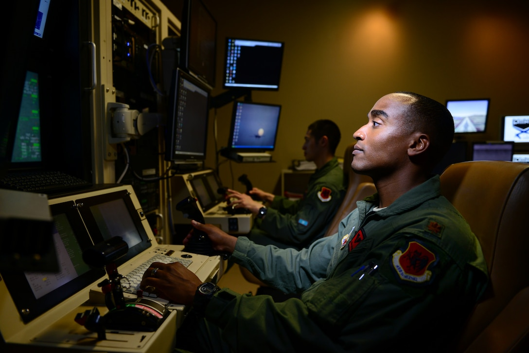 Maj. Bishane, a 432nd Aircraft Maintenance Squadron MQ-9 Reaper pilot, controls an aircraft from Creech Air Force Base, Nev. Remotely piloted aircraft pilots work closely with intelligence officers, sensor operators and maintainers to complete mission objectives. RPA personnel deal with the stressors of deployed service members while maintaining the normalcy of their day-to-day lives through programs designed to enhance communication skills, family and spiritual growth. (U.S. Air Force photo/Staff Sgt. Vernon Young Jr.)