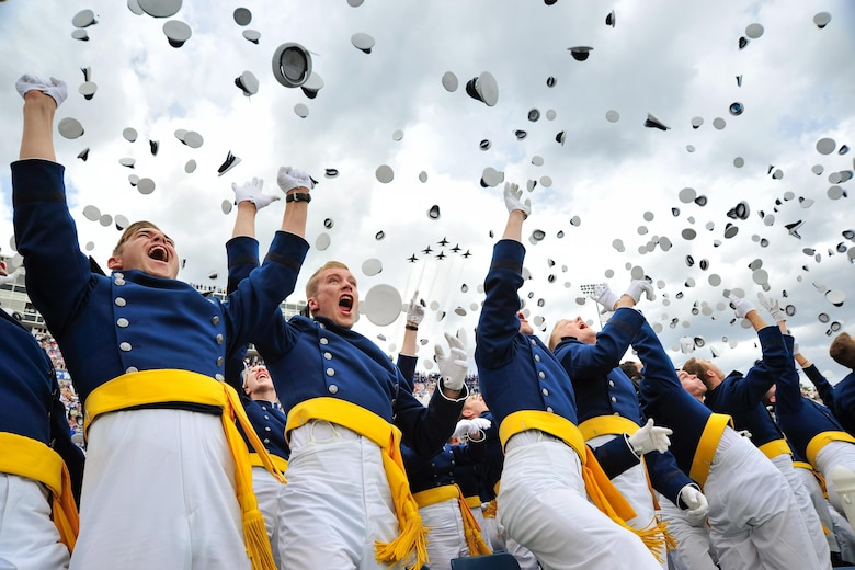 The U.S. Air Force Academy's Class of 2015 tosses their hats in celebration as the Thunderbirds roar over Falcon Stadium in Colorado Springs, Colo., May 28, 2015. Over 800 cadets graduated and became second lieutenants. Secretary of the Air Force Deborah Lee James addressed the graduates during the ceremony. (U.S. Air Force photo/Liz Copan)