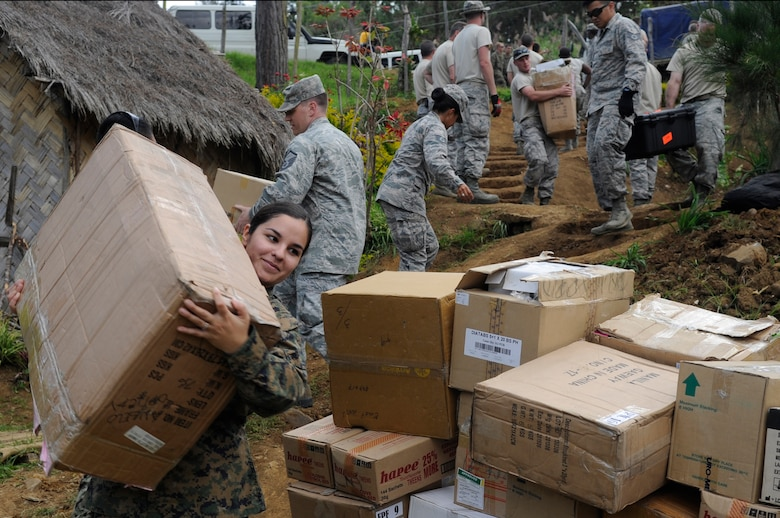 Marine Corps Hospital Corpsman Melissa Irvin, a 1st Dental Battalion dental corpsman from Camp Pendleton, Calif., carries a box of medical supplies to Unggai Primary School, where medical professionals are setting up during Pacific Angel 15-4 at Eastern Highlands, Papua New Guinea, May 29, 2015. Efforts undertaken during Pacific Angel help multilateral militaries in the Pacific improve and build relationships across a wide spectrum of civic operations, which bolsters each nation's capacity to respond and support future humanitarian assistance and disaster relief operations. (U.S. Air Force photo/Staff Sgt. Marcus Morris)