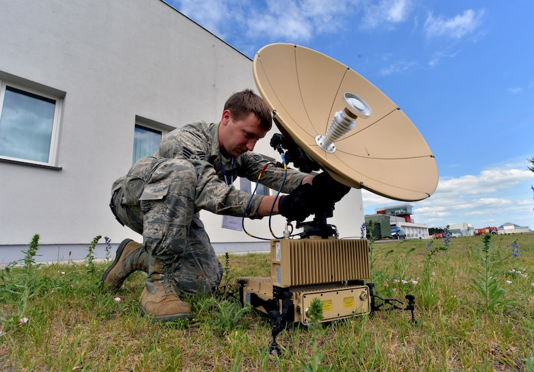 Senior Airman Brendan Kennedy, a 1st Combat Communications Squadron satellite communications technician, calibrates an L3 Panther during Baltic Operations 2015 June 10, 2015, at Powidz Air Base, Poland. During rotational deployments such as BALTOPS, each Airman on the communications team is selected for their specific skill set. (U.S. Air Force photo/Senior Airman Michael Battles)
