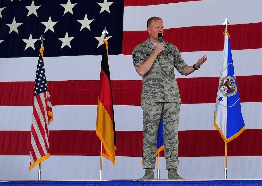 Chief Master Sgt. of the Air Force James A. Cody meets with Airmen during an all call June 15, 2015, at Ramstein Air Base, Germany. Cody answered Airmen's questions regarding Air Force standards, new processes and entitlements. (U.S. Air Force photo/Airman 1st Class Larissa Greatwood)