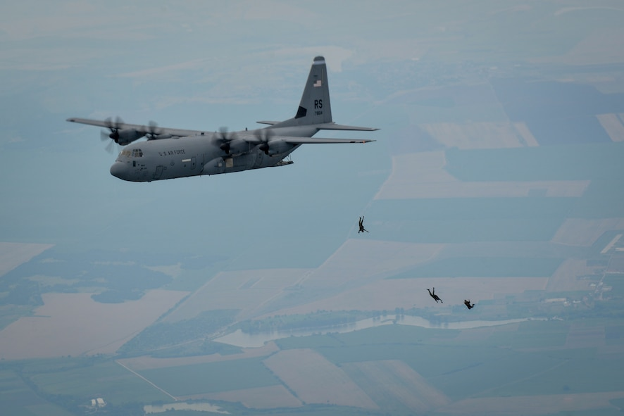 U.S. and Bulgarian paratroopers jump from a C-130J Super Hercules during a halo jump over Plovdiv, Bulgaria, July 14, 2015. During the three-hour formation flight, which consisted of two U.S. Air Force C-130Js and one Bulgarian air force C-27, more than 50 paratroopers exited the aircraft and landed near Plovdiv Airport. (U.S. Air Force photo/Senior Airman Nicole Sikorski)