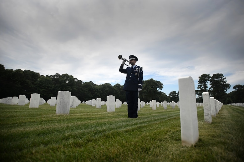 Senior Airman Michael C. Dancona and Senior Airman Dominic Surinaga, both members of the 106th Rescue Wing Honor Guard, conduct services at Calverton National Cemetery July 22, 2015. As part of their daily work, the 106th Honor Guard performs funeral services at military burial grounds throughout New York.
