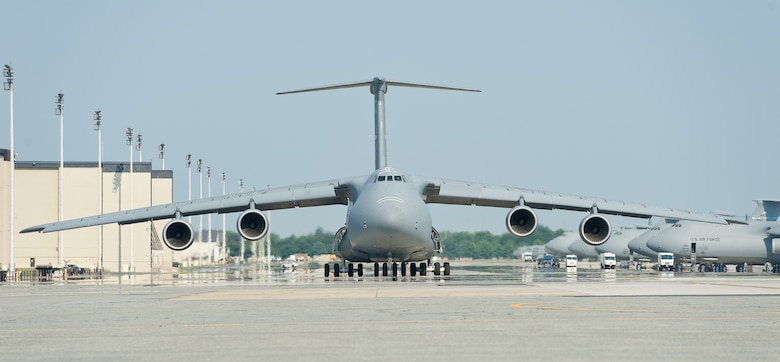 A C-5M Super Galaxy taxies down the flightline prior to takeoff Aug. 17, 2015, at Dover Air Force Base, Del. Eighteen C-5Ms are assigned to Dover AFB. (U.S. Air Force photo/Roland Balik)