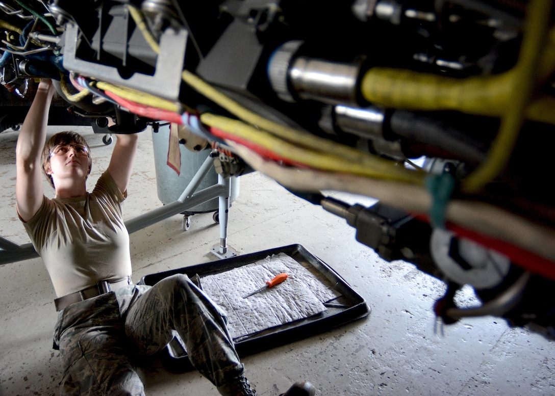 A Florida Air National Guard Airman from an aerospace propulsions flight installs a stator generator on an F100 Pratt and Whitney 200E jet engine Sept. 3, 2015, at the 125th Fighter Wing in Jacksonville, Fla. (U.S. Air Force photo/Tech. Sgt. Troy Anderson)