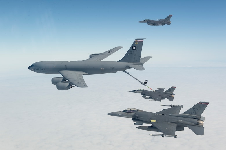 F-16 Fighting Falcons from the 408th Fighter Squadron at Spangdahlem Air Base, Germany, conduct aerial refueling with a KC-135 Stratotanker from the 100th Air Refueling Wing at Royal Air Force Mildenhall, England, during a training sortie Sept. 9, 2015, over the U.K. (U.S. Air Force photo/Tech. Sgt. Jason Robertson)