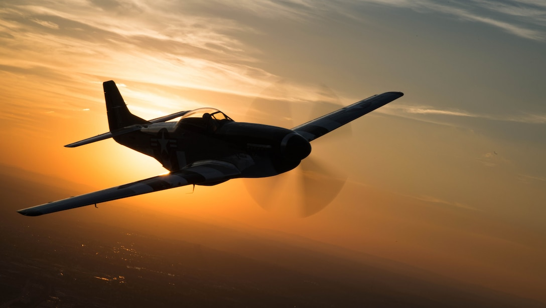 A P-51 Mustang flies over Joint Base Anacostia-Bolling, Washington, D.C., during a military tattoo Sept. 16, 2015. (U.S. Air Force photo/Airman 1st Class Philip Bryant)