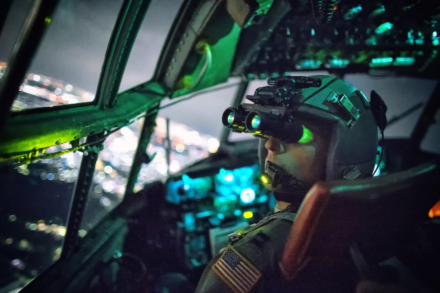 Capt. Thomas Bernard, a 36th Airlift Squadron C-130 Hercules pilot, performs a visual confirmation with night vision goggles during a training mission over Kanto Plain, Japan, Oct. 14, 2015. Yokota Air Base aircrews regularly conduct night flying operations to ensure they're prepared to respond to a variety of contingencies throughout the Indo-Asia-Pacific region. (U.S. Air Force photo/Osakabe Yasuo)