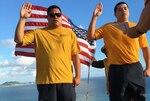 LS1 Roberto Lucero and LS2 Jamey Smith of DLA Maritime Pearl Harbor Maritime re-enlisted at the top of Lanikai Pillbox atop Ka'Iwa Ridge this December