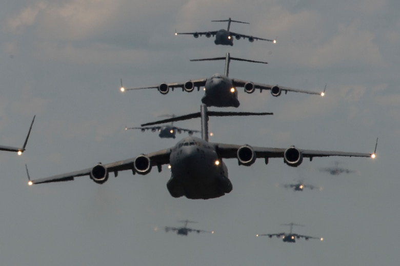 Members of the 437th Airlift Wing at Joint Base Charleston, S.C., conduct a multi-ship C-17 Globemaster III formation during Crescent Reach 15 on May 21, 2015. The exercise tested and evaluated JB Charleston's ability to launch a large aircraft formation in addition to processing and deploying duty passengers and cargo in response to a simulated crisis abroad. (U.S. Air Force photo/Staff Sgt. Corey Hook)