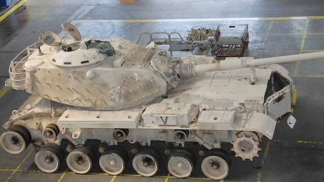Genesis II, an M60A1 Main Battle Tank, sits in the craneway of Marine Depot Maintenance Command waiting to be refurbished as part of a restoration project between MDMC and the National Museum of the Marine Corps, Sept. 5, 2015. Genesis II and it crew, attached to Company C, 3rd Tank Battalion, Marine Corps Base Twentynine Palms, Calif., spearheaded the Marine attack on the Southern frontier of Kuwait during the opening moments of Operation Desert Storm, earning a permanent place in the museum.