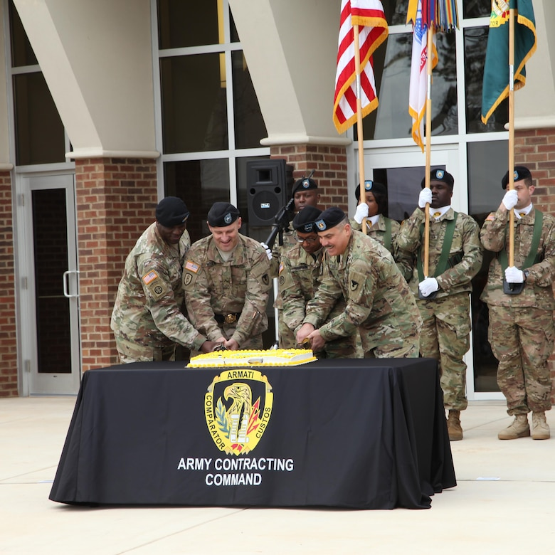 U.S. Army Contracting Command leadership cut the cake during the ribbon-cutting ceremony held at Redstone Arsenal, Alabama, to celebrate the completion of their newly renovated headquarters building Jan. 7.