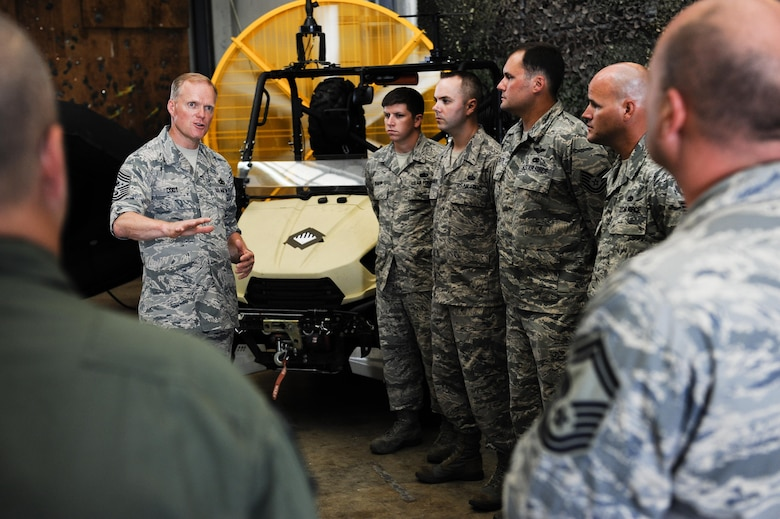 Chief Master Sgt. of the Air Force James Cody speaks to members of the 18th Communications Squadron, July 8, 2015, on Kadena Air Base, Japan. As part of his ongoing initiative to engage enlisted Airmen stationed around the globe, the chief will be continuing his tour through the Pacific Air Forces once he leaves Kadena. (U.S. Air Force photo by Airman 1st Class John Linzmeier)
