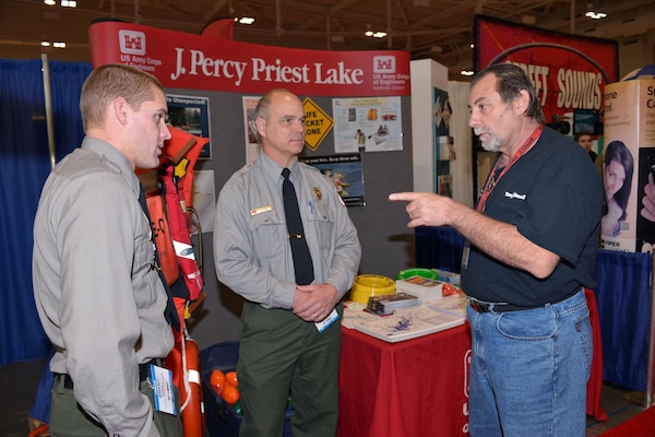 U.S. Army Corps of Engineers Nashville District Park Rangers Brent Sewell and Dave Funderburk from the Old Hickory Lake talk to boat captain,  Kirk Fonte from Nashville at the 30th annual Nashville Boat & Sportshow on Thursday, Jan. 7, 2016 in Music City Center.