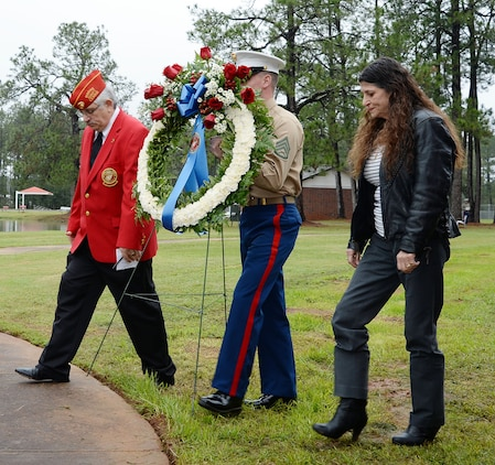 """Members of the Covella family lay a wreath during a rededication ceremony for Covella Pond in honor of late Gunnery Sgt. Joseph Covella, Jan. 8. The base pond was officially named """"Covella Pond"""" and marked with a bronze plaque mounted on a marble monument, Sept. 23, 1969. Covella was mortally wounded while serving as an advisor to the Armed Forces of the Republic of Vietnam, Jan. 3, 1966."""