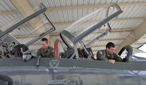 Capt. Chris Umphres, a 435th Fighter Training Squadron flight commander and instructor pilot, conducts a preflight check of a T-38 with 1st Lt. Kaleb Jenkins, a 435th FTS student pilot, before a training mission Jan. 5, 2016, at Joint Base San Antonio-Randolph, Texas. (U.S. Air Force photo/Tech. Sgt. Beth Anschutz)