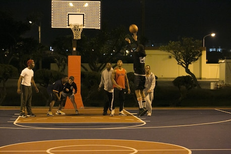 Status of Forces Agreement personnel participate in a basketball game Jan. 1 on Marine Corps Air Station Futenma, Okinawa, Japan. Participants received gift cards for competing at the end of the night. The game was hosted by MCAS Futenma's Single Marine Program and Navy Lt. Yonina E. Creditor, the station chaplain for MCAS Futenma. (Marine Corps Photo by Lance Cpl. Douglas D. Simons/Released)