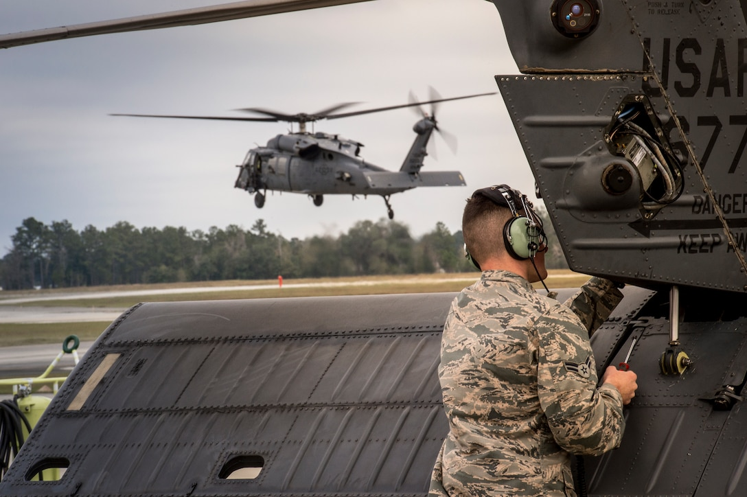An Airman from the 41st Helicopter Maintenance Unit attaches a panel to the tail of an HH-60G Pave Hawk, Jan. 7, 2016, at Moody Air Force Base, Ga. The 41st HMU works 24/7 to ensure aircraft are ready to fly at a moment's notice. (U.S. Air Force photo by Senior Airman Ryan Callaghan/Released)