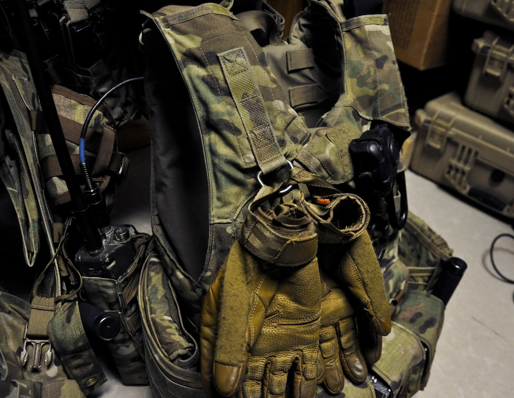 The 455th Expeditionary Security Forces Squadron Fly Away Security Team gear is readied during a pre-mission briefing before a flight to Jalalabad Airfield, Afghanistan Dec. 18, 2015. The 455th ESFS FAST is the all-encompassing security team that provides ground safety and cockpit denial to protect the aircraft and crew. (U.S. Air Force photo by Tech. Sgt. Nicholas Rau)