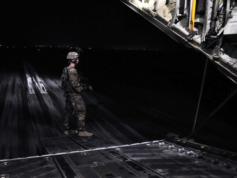 Airman 1st Class Seth Seward, 455th Expeditionary Security Forces Squadron Fly Away Security Team Defender, deployed from Offutt Air Force Base, Neb.,  secures the rear entrance of a C-130 Hercules during a mission to Jalalabad Airfield, Afghanistan Dec. 18, 2015. The 455th ESFS FAST is the all-encompassing security team that provides ground safety and cockpit denial to protect the aircraft and crew. (U.S. Air Force photo by Tech. Sgt. Nicholas Rau)