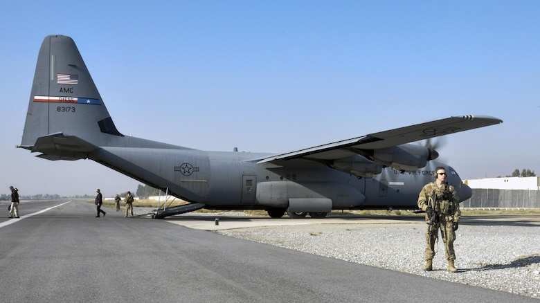 Staff Sgt. Tyler Berogan, 455th Expeditionary Security Forces Squadron Fly Away Security Team squad lead, deployed from Offutt Air Force Base, Neb.,  right, secures the flightline with his team at Jalalabad Airfield, Afghanistan Dec. 18, 2015. The 455th ESFS FAST is the all-encompassing security team that provides ground safety and cockpit denial to protect the aircraft and crew. (U.S. Air Force photo by Tech. Sgt. Nicholas Rau)