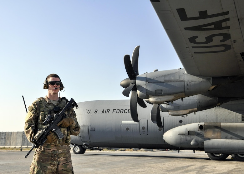 Airman 1st Class Seth Seward, 455th Expeditionary Security Forces Squadron Fly Away Security Team Defender, deployed from Offutt Air Force Base, Neb., provides half of the 360 degree security to a C-130 Hercules during a mission to Jalalabad Airfield, Afghanistan Dec. 18, 2015. The 455th ESFS FAST is the all-encompassing security team that provides ground safety and cockpit denial to protect the aircraft and crew. (U.S. Air Force photo by Tech. Sgt. Nicholas Rau)